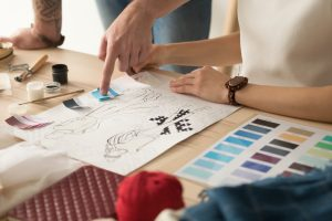 Two designers choosing fabric swatches.