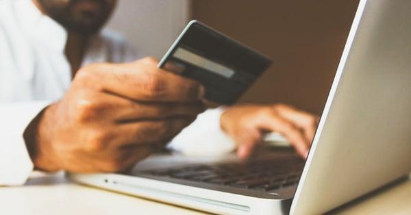 man purchasing online
